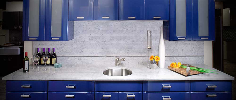 blue modern kitchen with marble counter top