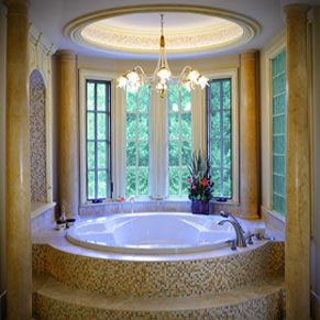 circular garden tub with bay windows mosaic tiles