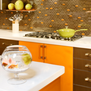 orange kitchen tile backsplash cook top