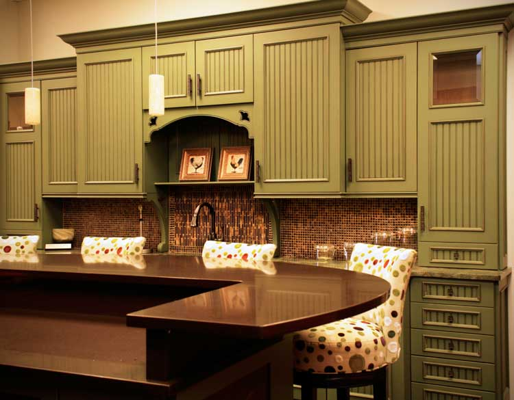traditional kitchen with beaded board green cabinets
